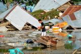 Tsunami Sweeps Indonesia Beach