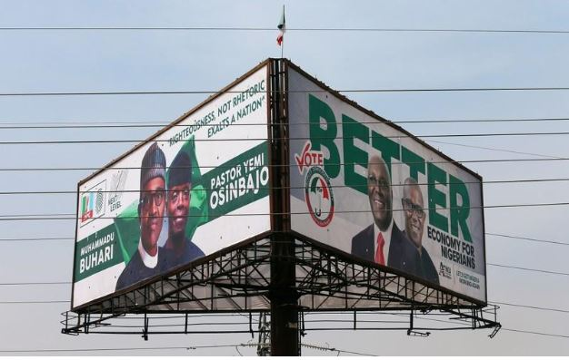 Election campaign billboards depicting Nigeria's President Muhammadu Buhari with his Vice President, Yemi Osinbajo, and Nigeria's main opposition party presidential candidate Atiku Abubakar with his running mate, Peter Obi, are pictured in Abuja, Nigeria February 5, 2019. REUTERS/Afolabi Sotunde