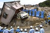 Rescue Workers Battle Mudslips, Waist-High Waters In Typhoon-Hit Japan
