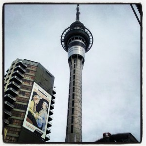 Sky Tower with high rise block next to it with huge poster advertising Downton Abbey