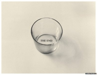 """empty glass with the words """"The End"""" imprinted on the bottom"""