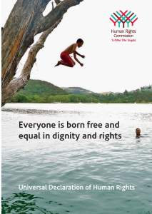 """poster from Human Rioghts Commision showing a child jumping in a river and with the words """"Everyone is born free and equal in dignity and rights"""