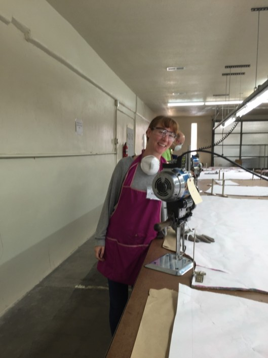 Kris. Notice the glove, dust mask and safety glasses. We're serious about safety at apparel manufacturing boot camp.
