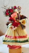 Corn husk doll with roses, statice and handmade Day of the Dead skull mask. Hair made from corn silk.