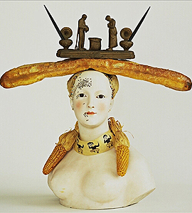Dalí_obra_busto_baguette