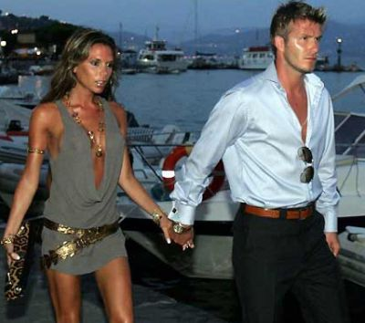David  Beckham  and his wife  Victoria     picture appears courtesy  pf  afp/reuters/ Tim Keeley  ...........