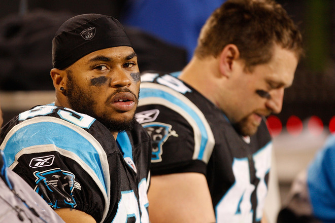 Disheartened Steve Smith and  teammate Brad Hoover of the  Carolina Panthers seated on the sidelines  during the waning moments of  the game ..............