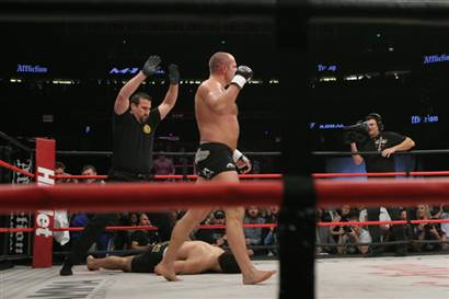 Ermialanenko  walks  away as referee  John  McCarthy calls the fight  over  with  Fedor  having  defeated  Andrei  Orlovski  ...........................