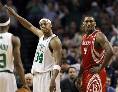 The Celtics' Paul Pierce  points to the sidelines having  been fouled by the Rockets' Ron Artest ..........