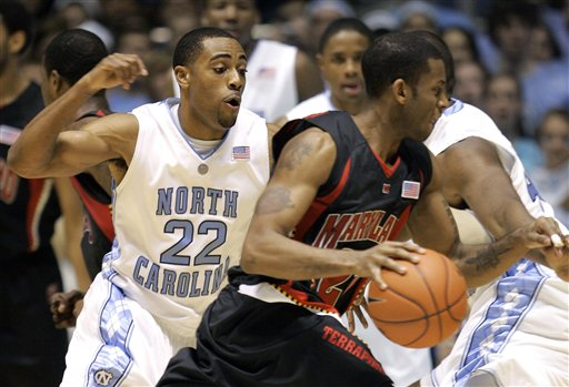 Maryland's Adrian  Bowie  handles the  ball  whilst the  defense  of  the Tar Heels'  Wayne Ellington tries to  defend the offensive  play.  picture appears courtesy of  ap/photo/Gerry Broome  ............