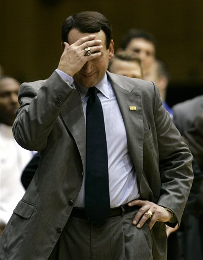 Blue Devils' coach knows  that the inevitable  is about  to  happen as  he  can no longer bear to watch the waning  moments  of  the  game .....................