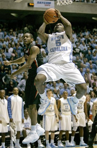 Tar Heels' Ty  Lawson(5) drives to the basket  as the  Terrapins'  Adrian Bowie is unable to  negate the play.  picture appears  courtesy  of  ap/photo/Gerry Broome ...................