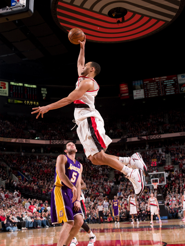 Brandon  Roy  of  the  Portland  Trailblazers   dunks  over the Lakers' Jordan Farmar  during  the  game  played  at the  Rose Garden  Arena   in Portland,Or.