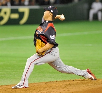 Daisuke  Matsuzaka  of  Japan  pitches  during  the  first  innings  of  Japan's  game  played  against  South Korea  in the  Tokyo  Dome  , Tokyo , Japan.   The  Japanese  team  would  go  on to defeat  their  Asian  rivals   14-2 .   picture  appears  courtesy  of afp/reuters / Toru Hanai ...............