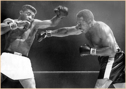Moore  in  a valiant  but  unsuccessful attempt  in  challenging  Floyd Patterson  for  the   heavyweight title  ...