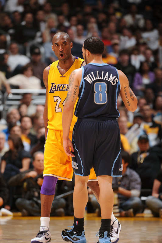 Kobe  Bryant  and   of  the  Los  Angeles Lakers  and  Deron  Williams  of  the Utah  Jazz  have  a  conversation  during  their  teams' final  regular  season  matchup  played  between the  two  respective   Western  Conference  teams.