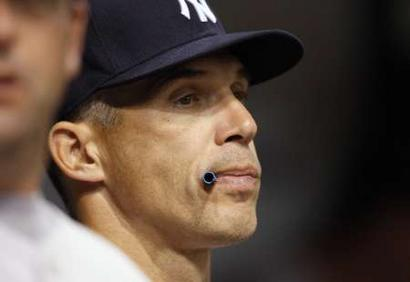 yankees-manager-joe-girardi-surveys-the-field-from-the-teams-dugout-as-the-game-reaches-its-culmination
