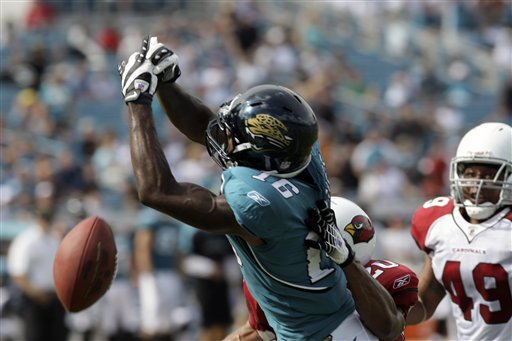 Jags' wide receiver  Nate  Hughes  (16) misses  a  pass in  the  second  half  of  a  game played   against the  Arizona  Cardinals .    The   Cardinals   would  go  on  to  defeat the  Jaguars   31-17  in  with  an  emphatic   victory.   picture appears  courtesy of  ap/photo/  John  Raoux ..................