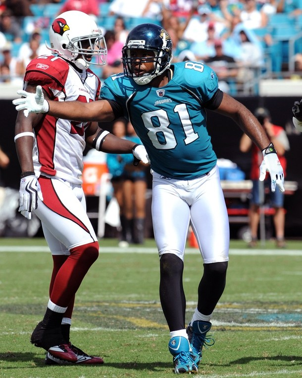 Jags'  wide  receiver  Torry   Holt  signals   a  completion   against the  Arizona   Cardinals    in  an   NFL  game   played   at  Jacksonville Municipal  Stadium .    The   Cardinals    would  defeat   the  Jaguars  31-17   in  a  game  played  on  Sunday  20th September  2009 .   picture appears   courtesy  of  getty  images/ Al   Messerschmidt   ...................