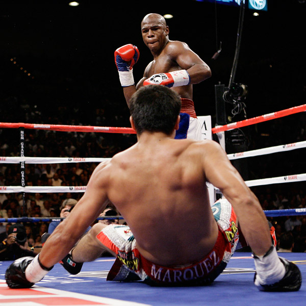 Mayweather  knocks   down  Marquez  in the  first  round  of   their  welterweight   bout   taking  place  at  the  MGM  Grand  Casino  Hotel  &  Resort  in    Las  Vegas,  Nevada .   picture  appears  courtesy  of  ap/photo/  Larry   Bouchard  ......................
