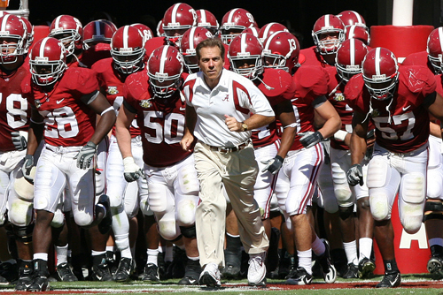 Nick Saban (center) leads  out  his Alabama  team ('The Crimson Tide') prior  to the start  of  NCAA college football game.  Saban  as a coach will be seeking  his  second national  title , having  won  a national championship  with LSU.    picture appears courtesy  of getty images/  Rich  Costello ..................