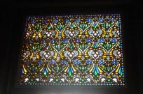 Beautiful stained-glass window inside a mausoleum.