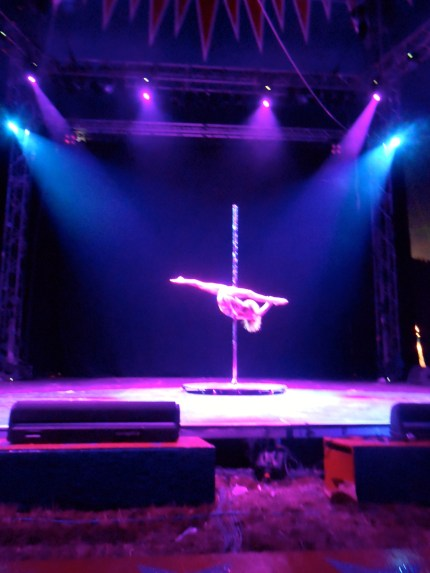A pole dancer in the Theatre & Circus Tent