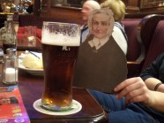 """Flat Agnes enjoying a traditional Irish pint while singing, """"Beer, beer, beer for old Flat Agnes Scott!"""""""