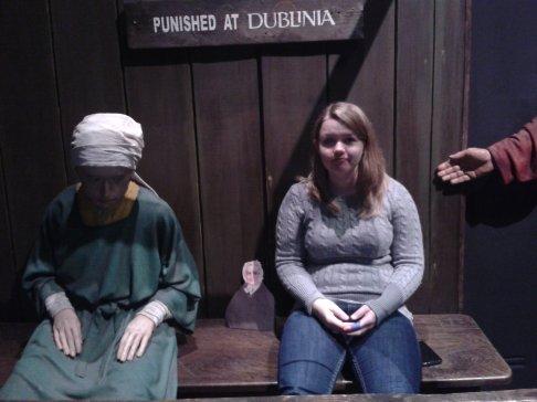 Flat Agnes and Alex facing medieval punishment at Dublinia museum in Dublin, Ireland