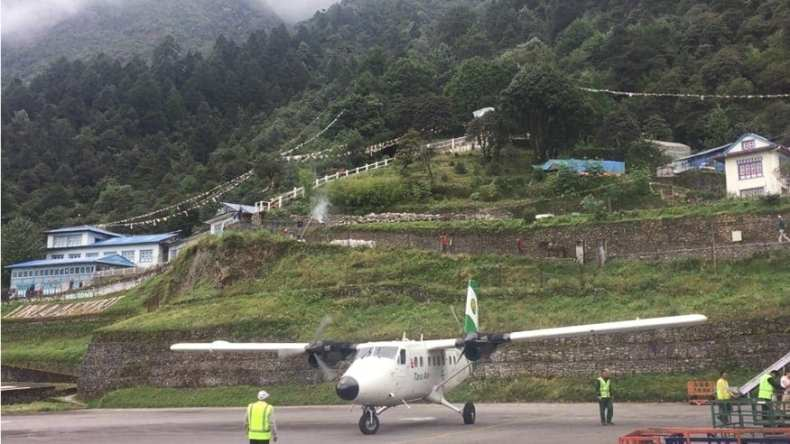 """A view of the flying golf cart (called an """"airplane"""" in Nepal) that took me from Kathmandu to Lukla Airport - sitting on the flight line at Lukla Airport"""