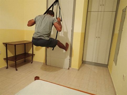 As part of my hotel room workout suspension trainers allow me to get in my pull ups, an essential upper body movement