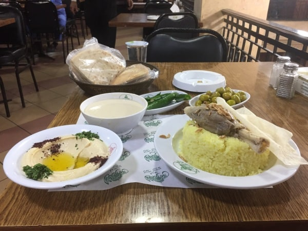 Mansaf, the national dish of Jordan must be properly enjoyed in Amman