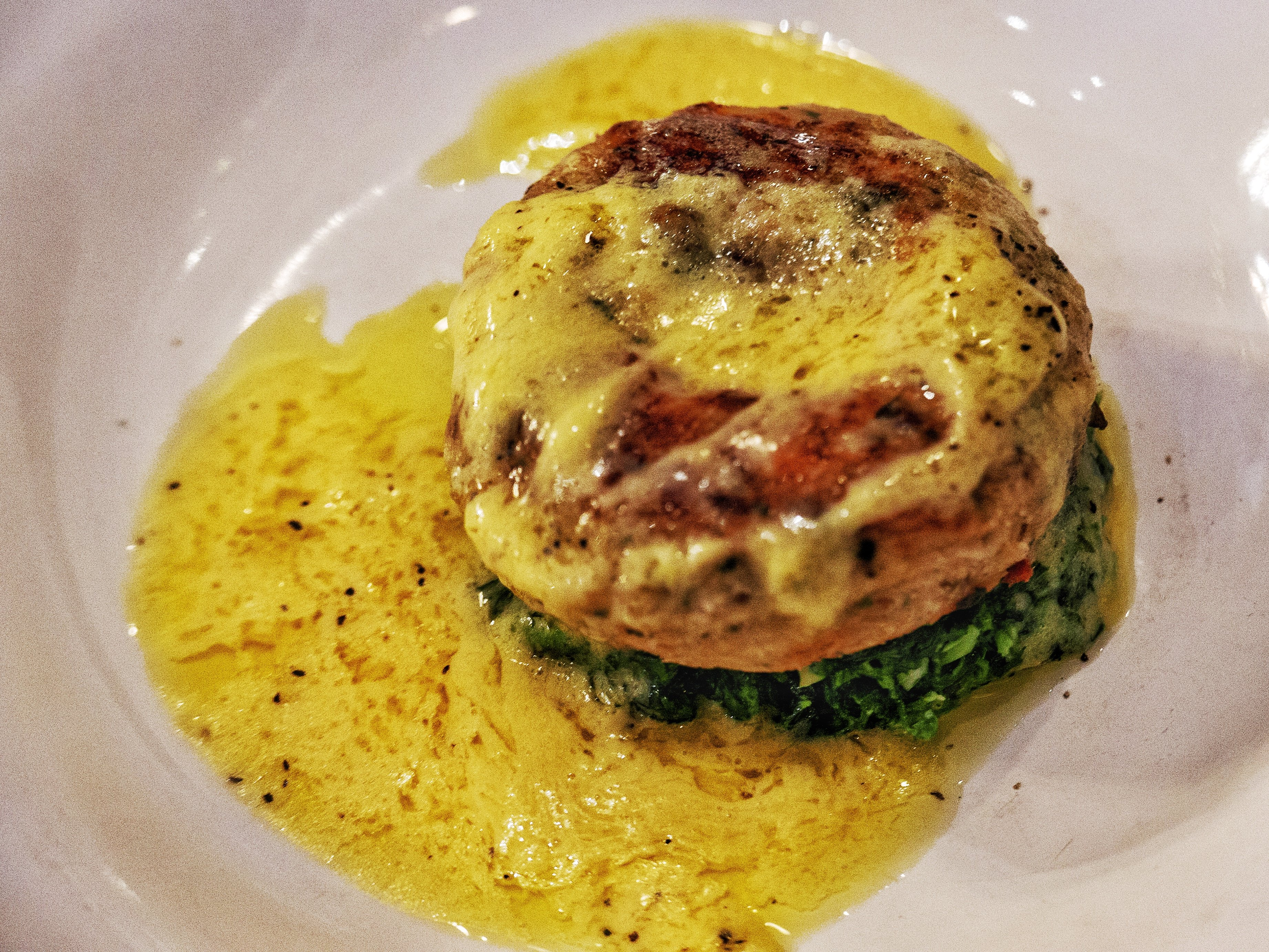 Starters at Bistrot Pierre: Panfried fishcake with wilted spinach and Hollandaise Sauce