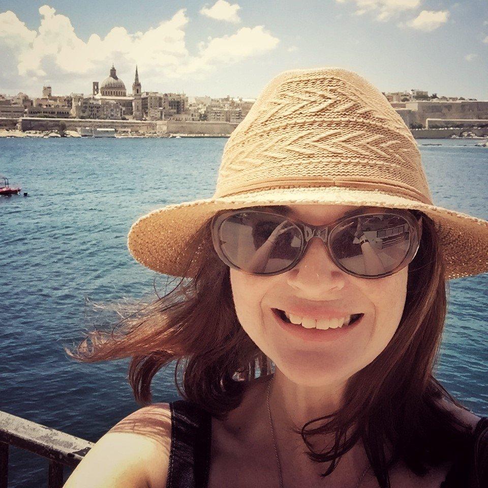 Girl in sunglasses and hat, Sliema, Valletta, Malta