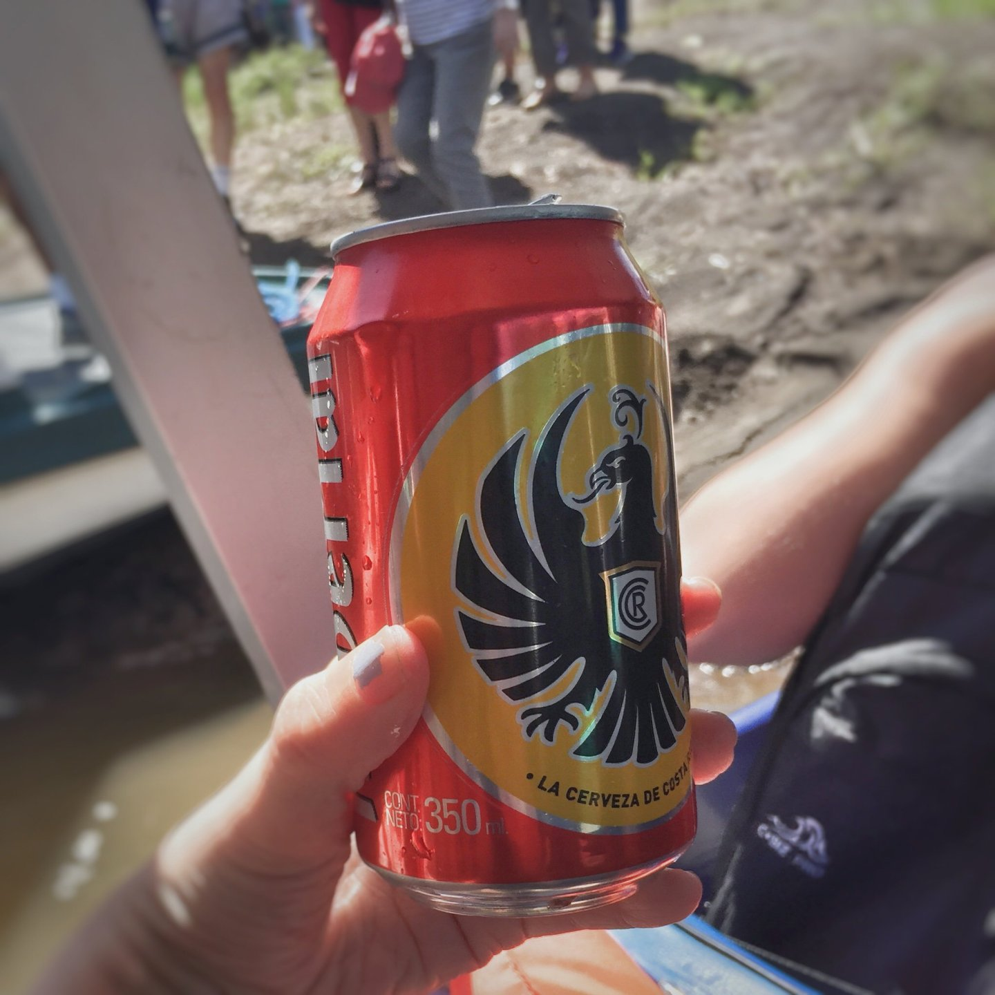 A sneaky can of the local beer Imperial on our boat trip to Tortuguero