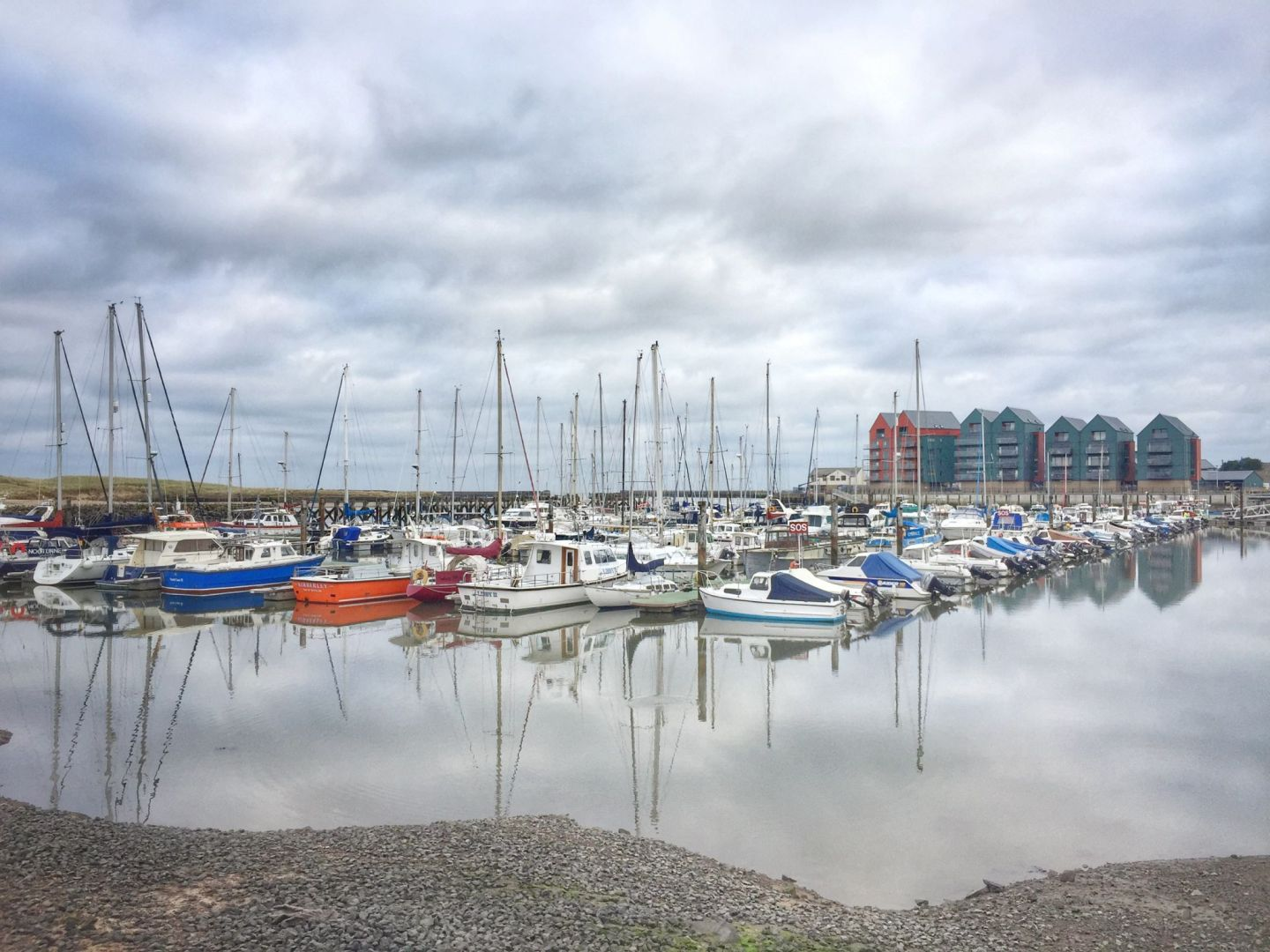 Hiking Amble to Alnmouth. Amble marina. Reflections of boats in the water