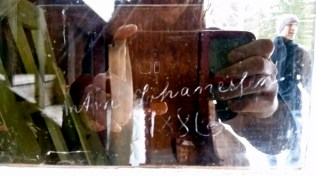A relative carved his name and the year into one of the windows of the house before leaving for the U.S.