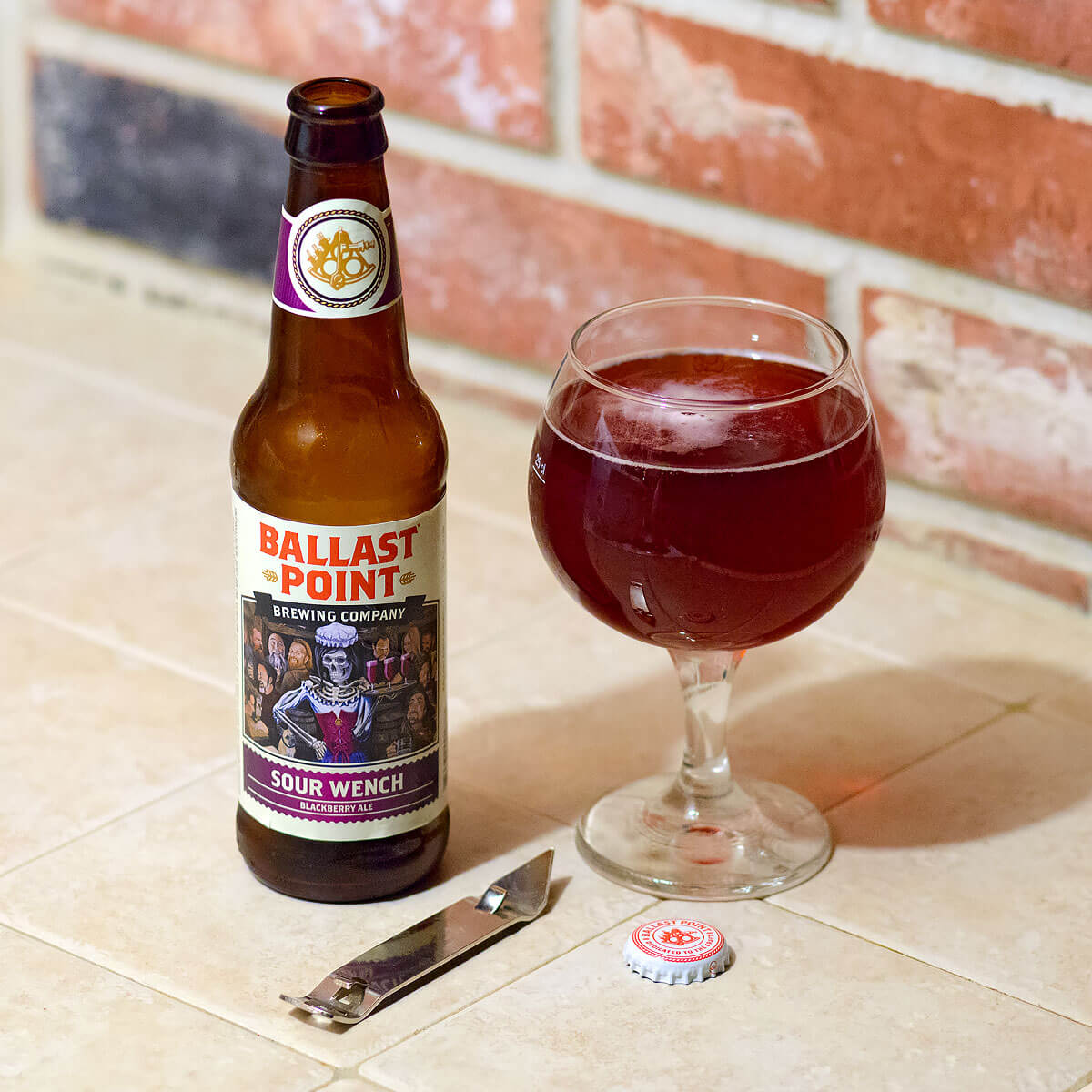 Sour Wench is a German-style Berliner Weisse by Ballast Point Brewing Company that refreshingly blends tart fruit flavors of blackberry and lemon.