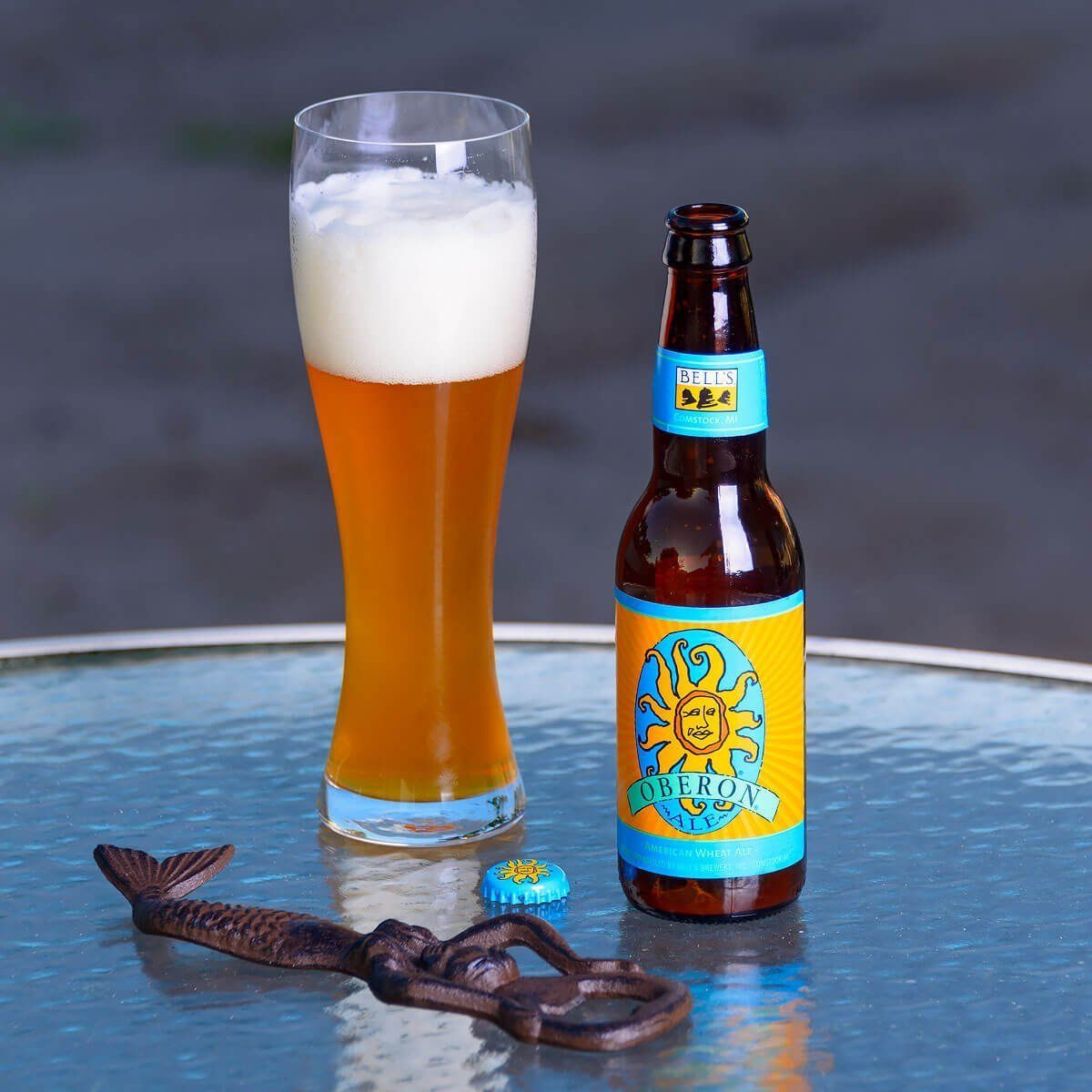 Oberon Ale is an American Wheat Ale by Bell's Brewery that blends doughy bread with spicy clove and pepper; refreshingly tart with lemon and orange.
