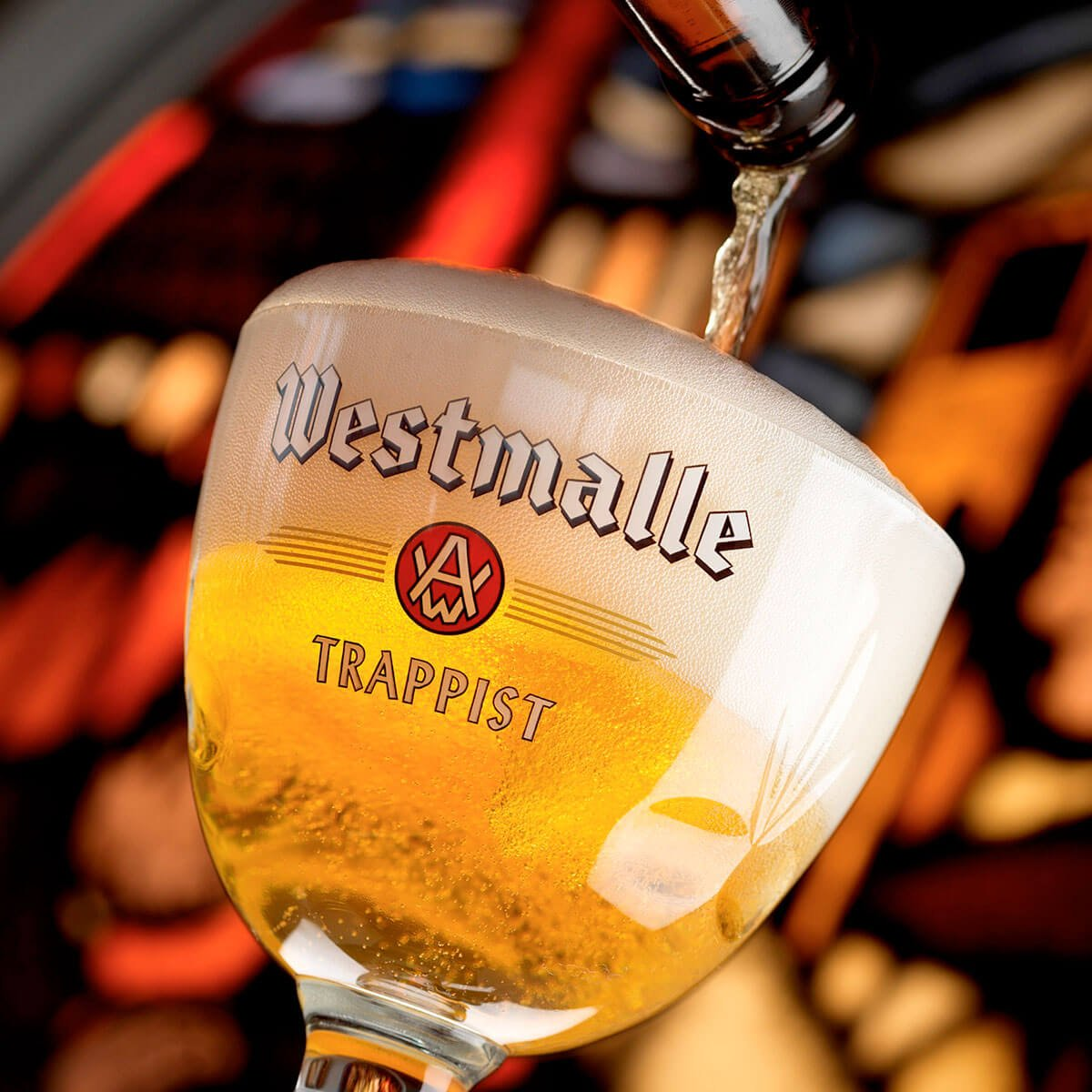 Pouring the Westmalle Tripel into a Westmalle Brewery branded Goblet