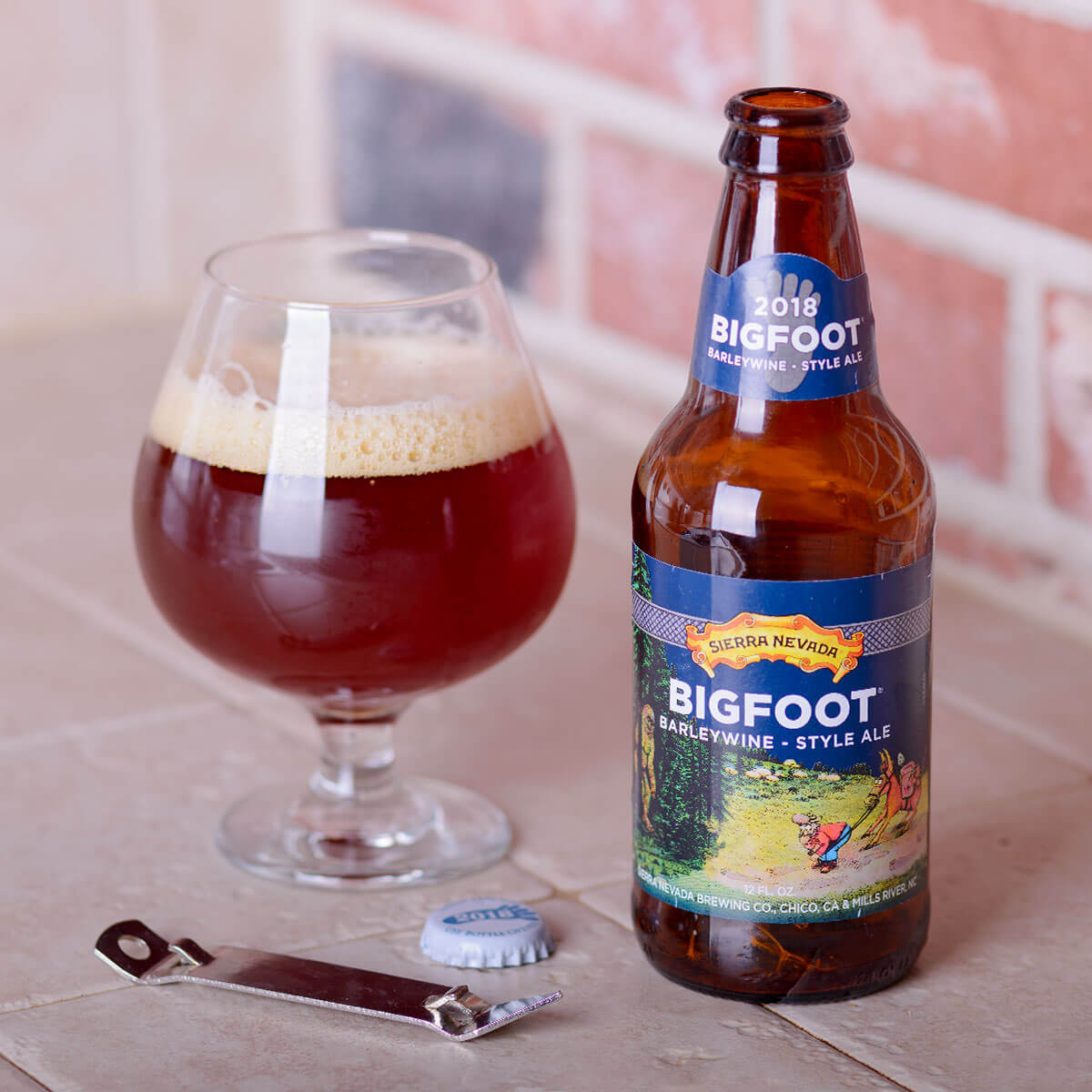 Bigfoot Barleywine Style Ale is an American Barleywine by Sierra Nevada Brewing Co. that blends piney and herbal hops with biscuit, caramel, dark fruit, and booze.