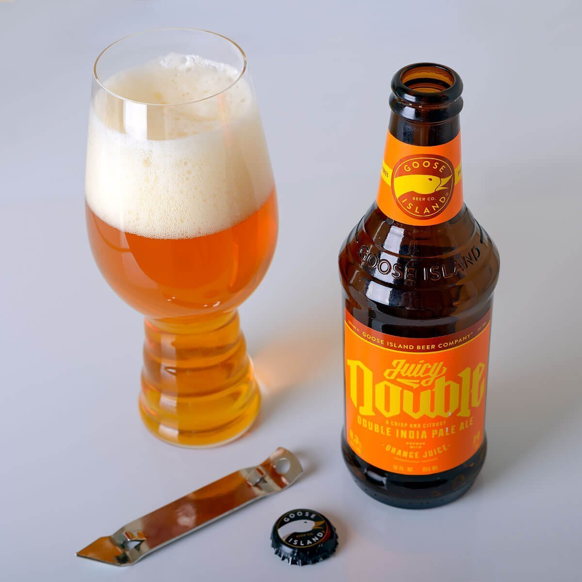 Juicy Double is an American Double IPA by Goose Island Beer Co. that blends sweet orange juice with citrus, piney hops, and booze.
