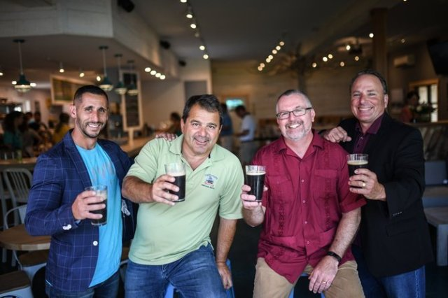 The Team of Shipyard Brewing and Vera Roasters Enjoy Glasses of their New Nitro Cold Brew Coffee