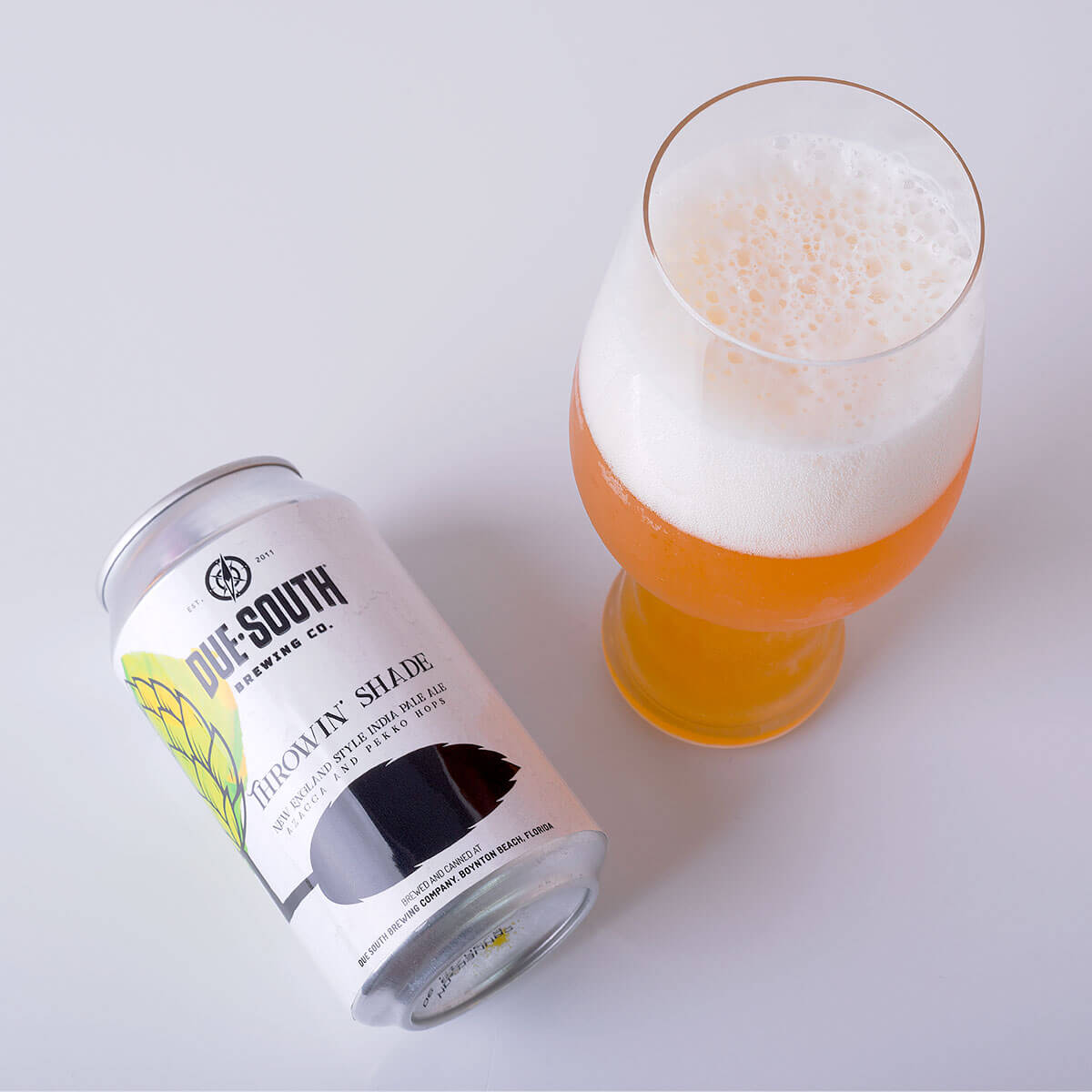Throwin' Shade is a New England IPA that's brewed by Due South Brewing Co. that features hoppy citrus and mellow tropical fruit.