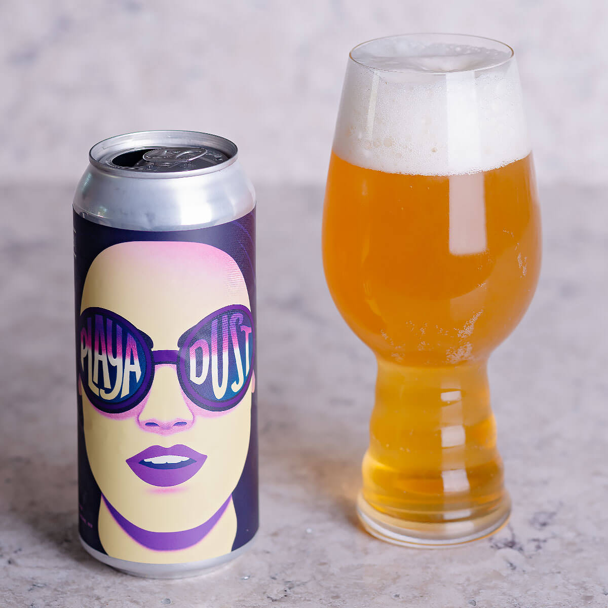 Playa Dust is a New England-style IPA by IMBĪB Custom Brews that blends hoppy citrus and tropical fruit with bready malt.