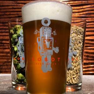 Pint of beer in a Mad Robot Brewing Co. branded beer glass