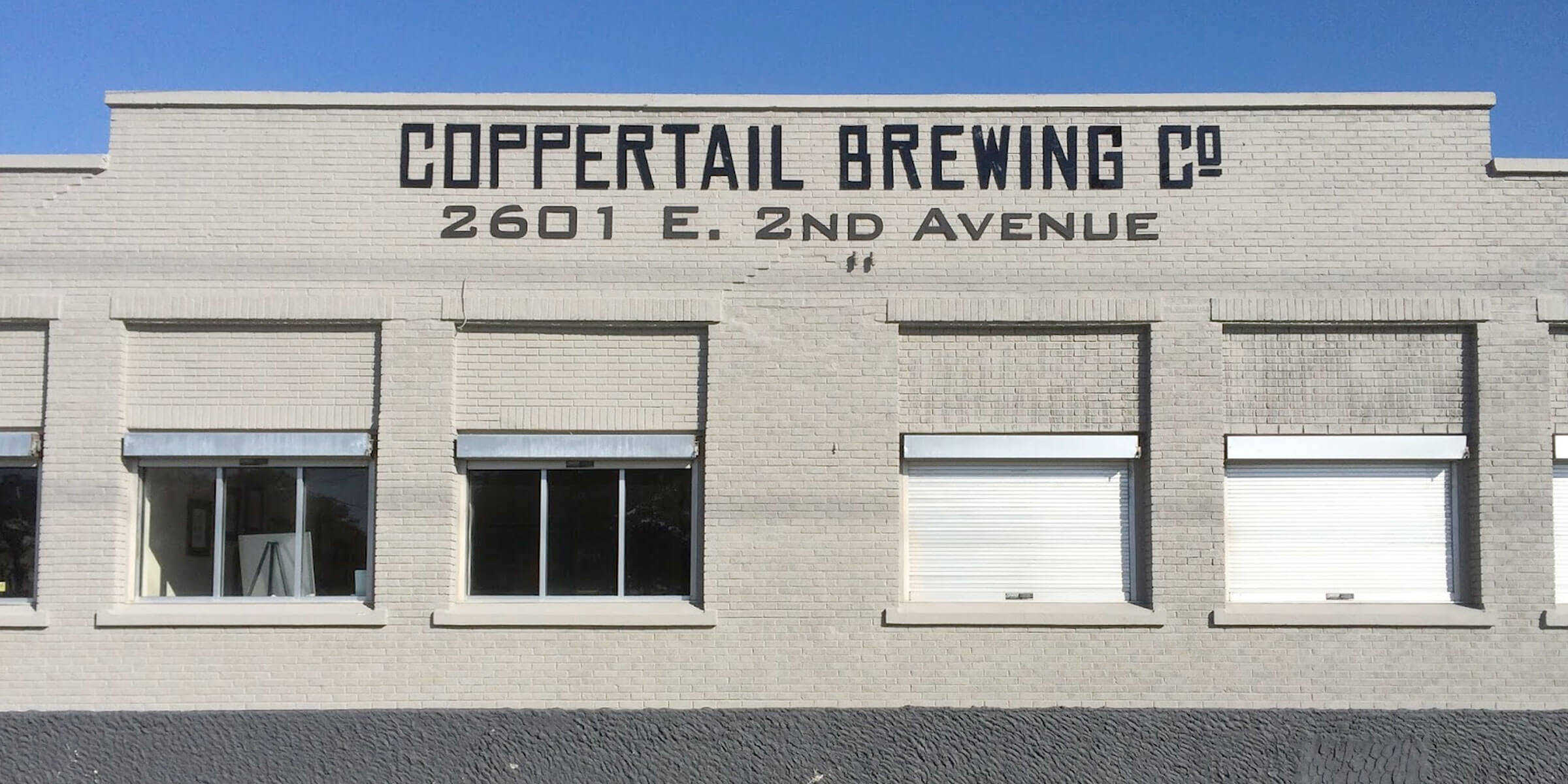 Outside the production brewery at Coppertail Brewing Co. in Tampa, Florida