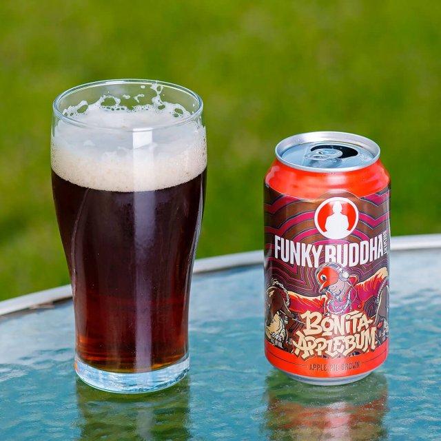 Bonita Applebum is an American Brown Ale by Funky Buddha Brewery that deftly balances baked bread, tart apple, cinnamon, and vanilla.