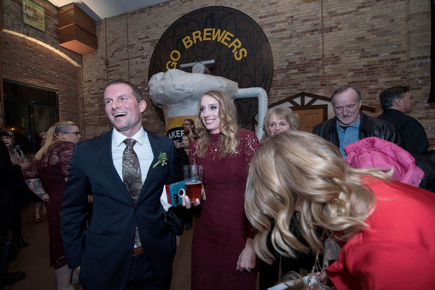 Photo of a happy couple who took advantage of the Valentine's Day wedding special from Lakefront Brewery