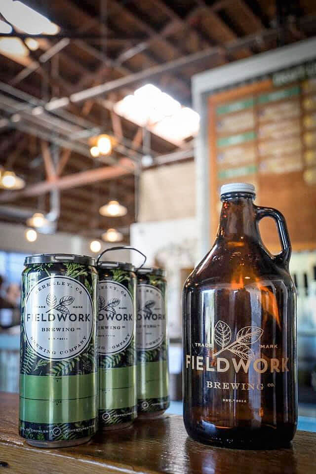 A trio of crowlers and a growler inside the taproom at Fieldwork Brewing Company in Corte Madera, California